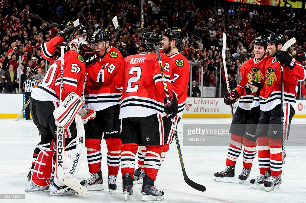<a gi-track='captionPersonalityLinkClicked' href=/galleries/search?phrase=Jonathan+Toews&family=editorial&specificpeople=537799 ng-click='$event.stopPropagation()'>Jonathan Toews</a> #19 of the Chicago Blackhawks celebrates with teammate goalie <a gi-track='captionPersonalityLinkClicked' href=/galleries/search?phrase=Corey+Crawford&family=editorial&specificpeople=818935 ng-click='$event.stopPropagation()'>Corey Crawford</a> #50 after the Blackhawks defeated the Nashville Predators 3-2, as <a gi-track='captionPersonalityLinkClicked' href=/galleries/search?phrase=Bryan+Bickell&family=editorial&specificpeople=241498 ng-click='$event.stopPropagation()'>Bryan Bickell</a> #29 and <a gi-track='captionPersonalityLinkClicked' href=/galleries/search?phrase=Michal+Rozsival&family=editorial&specificpeople=216462 ng-click='$event.stopPropagation()'>Michal Rozsival</a> #32 skate up to join the group, during the NHL game on April 01, 2013 at the United Center in Chicago, Illinois.