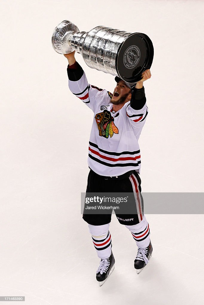 Jonathan Toews #19 of the Chicago Blackhawks celebrates with the Stanley Cup after they won 3-2 against the Boston Bruins in Game Six of the 2013 NHL Stanley Cup Final at TD Garden on June 24, 2013 in Boston, Massachusetts.