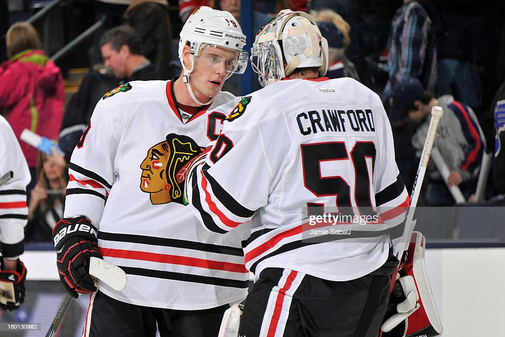 Jonathan Toews #19 of the Chicago Blackhawks congratulates goaltender Corey Crawford #50 of the Chicago Blackhawks after the Blackhawks defeated the Columbus Blue Jackets 3-2 on January 26, 2013 at Nationwide Arena in Columbus, Ohio. Chicago has started the season 5-0 for the first time in team history.