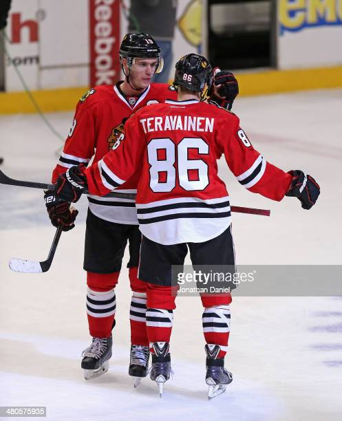 Jonathan Toews of the Chicago Blackhawks congratulates Teuvo Teravainen after Teravainen's NHL debut against the Dallas Stars at the United Center on...