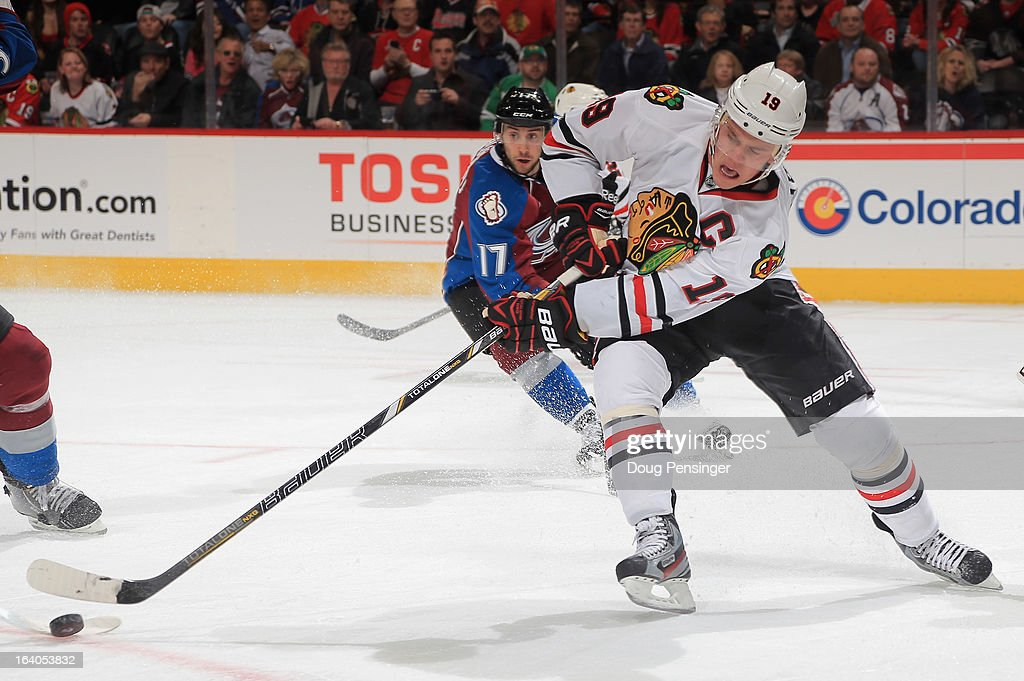 <a gi-track='captionPersonalityLinkClicked' href=/galleries/search?phrase=Jonathan+Toews&family=editorial&specificpeople=537799 ng-click='$event.stopPropagation()'>Jonathan Toews</a> #19 of the Chicago Blackhawks controls the puck against Aaron Palushaj #17 of the Colorado Avalanche at the Pepsi Center on March 18, 2013 in Denver, Colorado. The Blackhawks defeated the Avalanche 5-2.