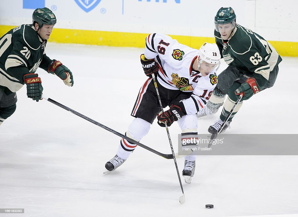 <a gi-track='captionPersonalityLinkClicked' href=/galleries/search?phrase=Jonathan+Toews&family=editorial&specificpeople=537799 ng-click='$event.stopPropagation()'>Jonathan Toews</a> #19 of the Chicago Blackhawks controls the puck against <a gi-track='captionPersonalityLinkClicked' href=/galleries/search?phrase=Ryan+Suter&family=editorial&specificpeople=583306 ng-click='$event.stopPropagation()'>Ryan Suter</a> #20 and Charlie Coyle #63 of the Minnesota Wild during the third period on April 9, 2013 at Xcel Energy Center in St Paul, Minnesota. The Blackhawks defeated the Wild 1-0.