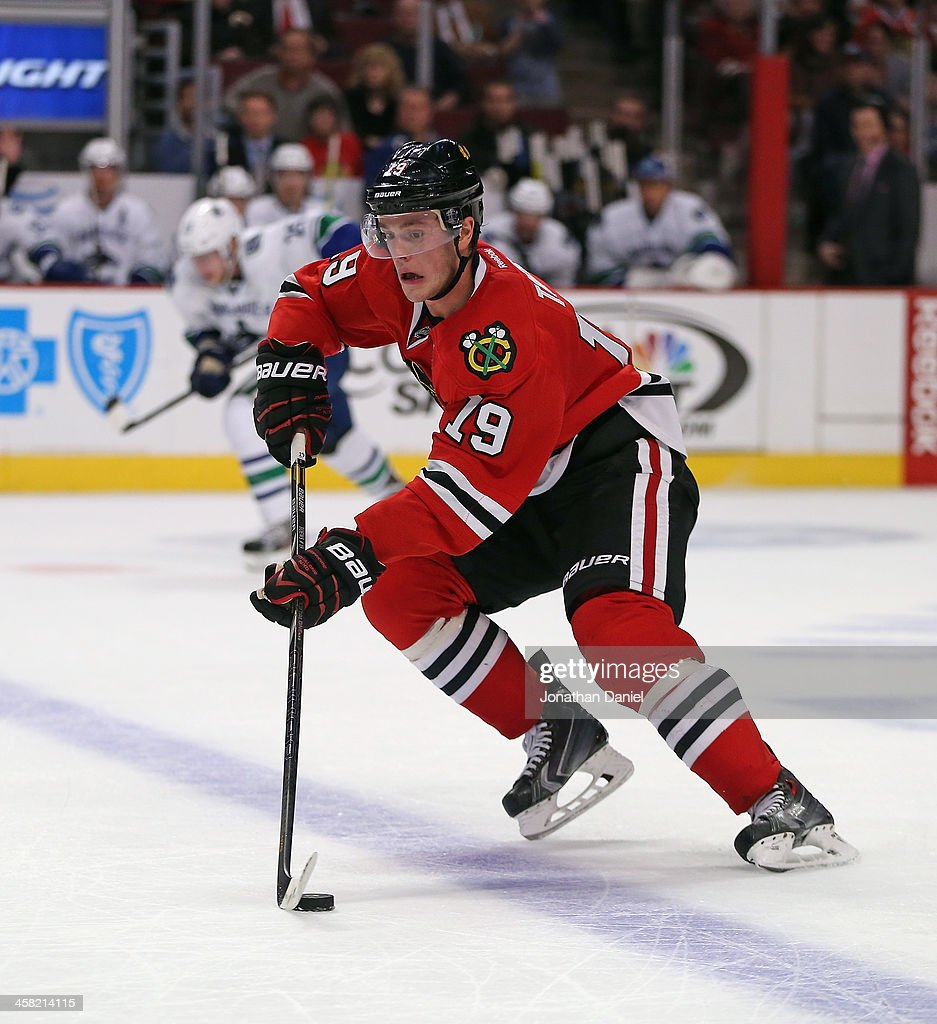 <a gi-track='captionPersonalityLinkClicked' href=/galleries/search?phrase=Jonathan+Toews&family=editorial&specificpeople=537799 ng-click='$event.stopPropagation()'>Jonathan Toews</a> #19 of the Chicago Blackhawks controls the puck against the Vancouver Canucks at the United Center on December 20, 2013 in Chicago, Illinois. The Canucks defeated the Blackhawks 3-2 in a shootout.