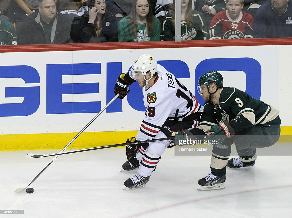 Jonathan Toews #19 of the Chicago Blackhawks controls the puck against Mikko Koivu #9 of the Minnesota Wild during the third period in Game Three of the Second Round of the 2014 NHL Stanley Cup Playoffs on May 6, 2014 at Xcel Energy Center in St Paul, Minnesota. The Wild defeated the Blackhawks 4-0.