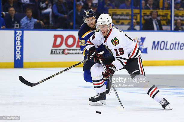 Jonathan Toews of the Chicago Blackhawks controls the puck against Kevin Shattenkirk of the St Louis Blues in Game One of the Western Conference...