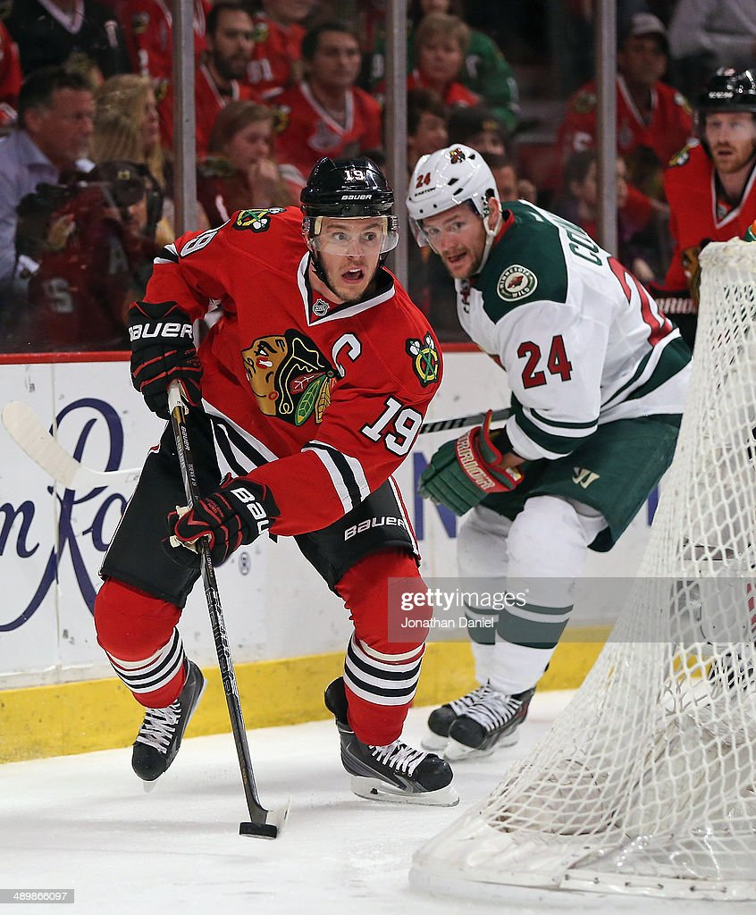 <a gi-track='captionPersonalityLinkClicked' href=/galleries/search?phrase=Jonathan+Toews&family=editorial&specificpeople=537799 ng-click='$event.stopPropagation()'>Jonathan Toews</a> #19 of the Chicago Blackhawks controls the puck behind the net in front of <a gi-track='captionPersonalityLinkClicked' href=/galleries/search?phrase=Matt+Cooke&family=editorial&specificpeople=592551 ng-click='$event.stopPropagation()'>Matt Cooke</a> #24 of the Minnesota Wild in Game Five of the Second Round of the 2014 NHL Stanley Cup Playoffs at the United Center on May 11, 2014 in Chicago, Illinois. The Blackhawks defeated the Wild 2-1.