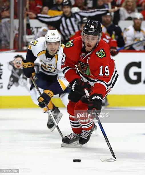 Jonathan Toews of the Chicago Blackhawks controls the puck in front of Kevin Fiala of the Nashville Predators in Game One of the Western Conference...
