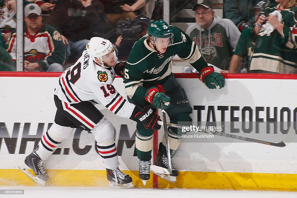 Jonathan Toews #19 of the Chicago Blackhawks defends Jonas Brodin #25 of the Minnesota Wild during Game Six of the Second Round of the 2014 Stanley Cup Playoffs on May 13, 2014 at the Xcel Energy Center in St. Paul, Minnesota.