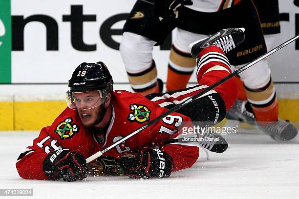 Jonathan Toews of the Chicago Blackhawks dives for a loose puck in the closing minutes against the Anaheim Ducks in Game Three of the Western...