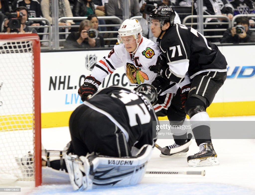 Jonathan Toews #19 of the Chicago Blackhawks drives to the net as he is folowed by Jordan Nolan #71 of the Los Angeles Kings for a shot on Jonathan Quick #32 at Staples Center on January 19, 2013 in Los Angeles, California.