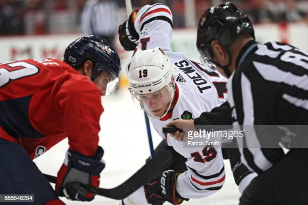 Jonathan Toews of the Chicago Blackhawks faces off against the Washington Capitals during the third period at Capital One Arena on December 06 2017...