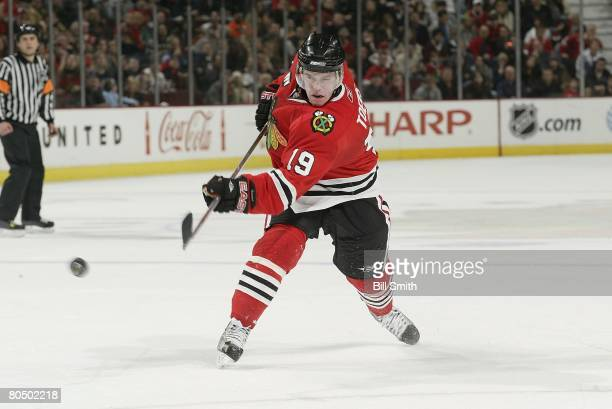 Jonathan Toews of the Chicago Blackhawks fires a shot against the Columbus Blue Jackets on March 30 2008 at the United Center in Chicago Illinois