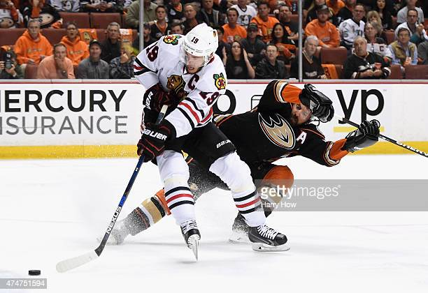 Jonathan Toews of the Chicago Blackhawks gets past Francois Beauchemin of the Anaheim Ducks in the second period of Game Five of the Western...