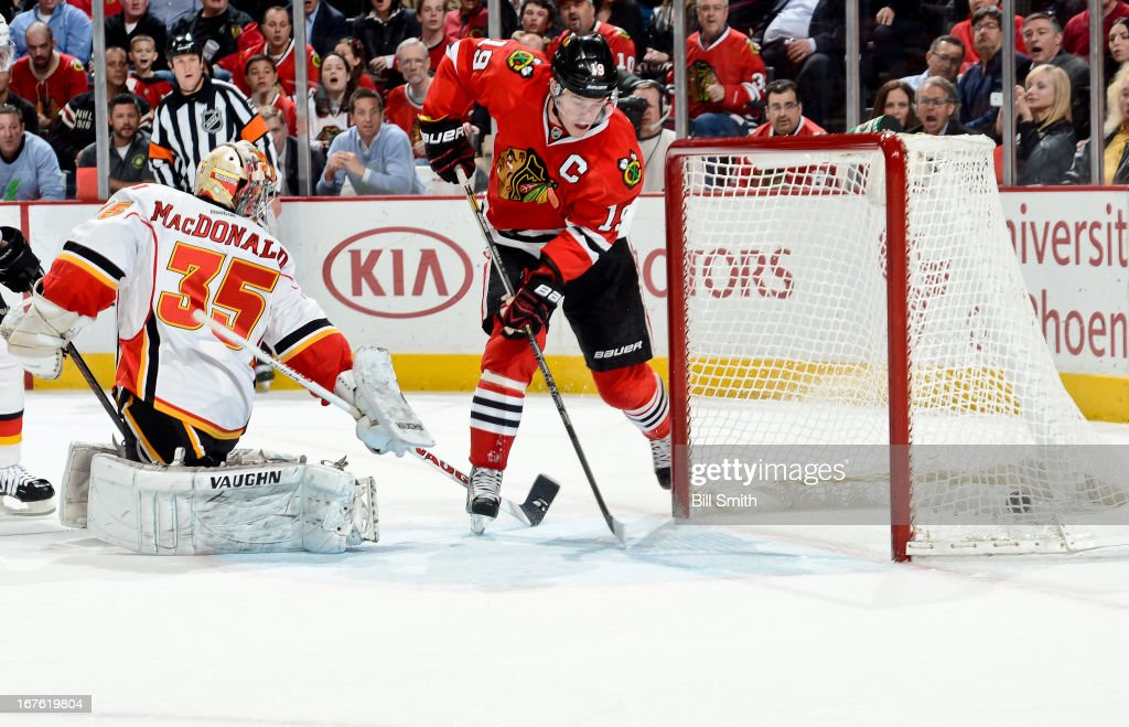<a gi-track='captionPersonalityLinkClicked' href=/galleries/search?phrase=Jonathan+Toews&family=editorial&specificpeople=537799 ng-click='$event.stopPropagation()'>Jonathan Toews</a> #19 of the Chicago Blackhawks gets the puck in the net behind goalie <a gi-track='captionPersonalityLinkClicked' href=/galleries/search?phrase=Joey+MacDonald&family=editorial&specificpeople=2234367 ng-click='$event.stopPropagation()'>Joey MacDonald</a> #35 of the Calgary Flames to score in the first period during the NHL game on April 26, 2013 at the United Center in Chicago, Illinois.