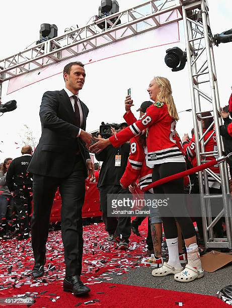 Jonathan Toews of the Chicago Blackhawks greets fans on the red carpet before the first game of the season against the New York Rangers during an NHL...