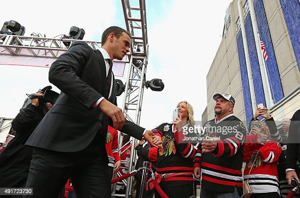 Jonathan Toews of the Chicago Blackhawks greets fans on the red carpet beofre the first game of the season against the New York Rangers during an NHL...