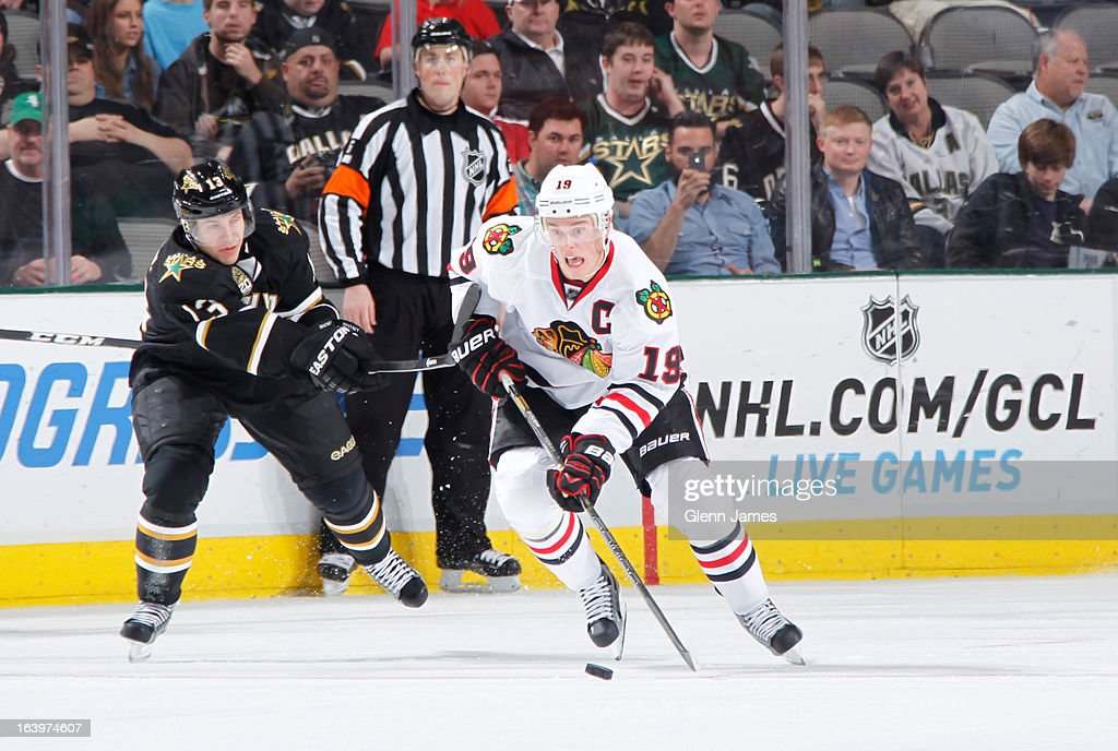 <a gi-track='captionPersonalityLinkClicked' href=/galleries/search?phrase=Jonathan+Toews&family=editorial&specificpeople=537799 ng-click='$event.stopPropagation()'>Jonathan Toews</a> #19 of the Chicago Blackhawks handles the puck against <a gi-track='captionPersonalityLinkClicked' href=/galleries/search?phrase=Ray+Whitney&family=editorial&specificpeople=202090 ng-click='$event.stopPropagation()'>Ray Whitney</a> #13 of the Dallas Stars at the American Airlines Center on March 16, 2013 in Dallas, Texas.