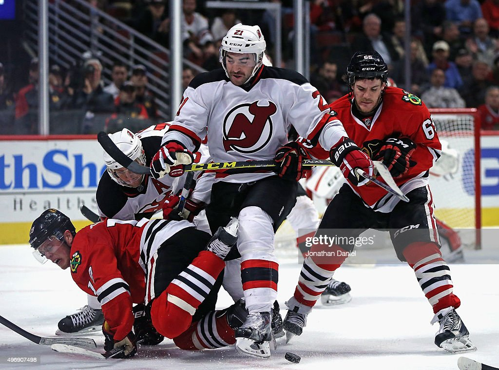 <a gi-track='captionPersonalityLinkClicked' href=/galleries/search?phrase=Jonathan+Toews&family=editorial&specificpeople=537799 ng-click='$event.stopPropagation()'>Jonathan Toews</a> #19 of the Chicago Blackhawks hits the ice after a face-off as teammate <a gi-track='captionPersonalityLinkClicked' href=/galleries/search?phrase=Andrew+Shaw+-+Joueur+de+hockey+sur+glace&family=editorial&specificpeople=10568695 ng-click='$event.stopPropagation()'>Andrew Shaw</a> #65 battles with <a gi-track='captionPersonalityLinkClicked' href=/galleries/search?phrase=Kyle+Palmieri&family=editorial&specificpeople=4783296 ng-click='$event.stopPropagation()'>Kyle Palmieri</a> #21 of the New Jersey Devils for the puck at the United Center on November 12, 2015 in Chicago, Illinois. The Devils defeated the Blackhawks 3-2.