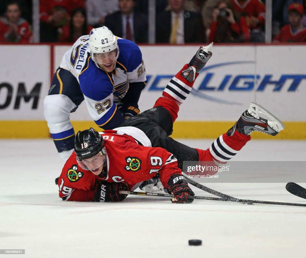 <a gi-track='captionPersonalityLinkClicked' href=/galleries/search?phrase=Jonathan+Toews&family=editorial&specificpeople=537799 ng-click='$event.stopPropagation()'>Jonathan Toews</a> #19 of the Chicago Blackhawks hits the ice after battling with <a gi-track='captionPersonalityLinkClicked' href=/galleries/search?phrase=Alex+Pietrangelo&family=editorial&specificpeople=4072229 ng-click='$event.stopPropagation()'>Alex Pietrangelo</a> #27 of the St. Louis Blues at the United Center on April 4, 2013 in Chicago, Illinois. The Blues defeated the Blackhawks 4-3 in a shootout.