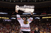 Jonathan Toews of the Chicago Blackhawks hoist the Stanley Cup Trophy after defeating the Boston Bruins in Game Six of the 2013 NHL Stanley Cup Final...