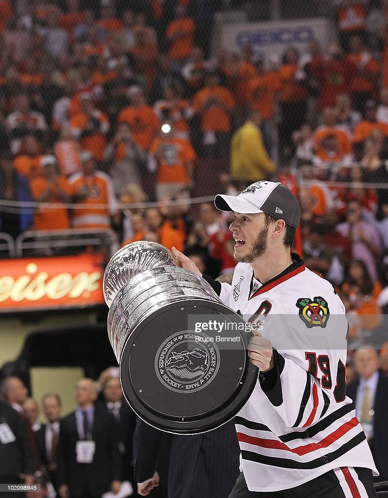 Jonathan Toews #19 of the Chicago Blackhawks hoists the Stanley Cup after the Blackhawks defeated the Philadelphia Flyers 4-3 in overtime to win the Stanley Cup in Game Six of the 2010 NHL Stanley Cup Final at the Wachovia Center on June 9, 2010 in Philadelphia, Pennsylvania.