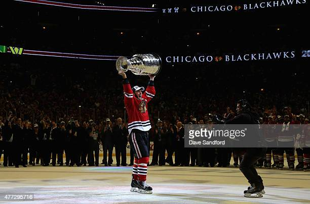 Jonathan Toews of the Chicago Blackhawks hoists the Stanley Cup in celebration of his team's 20 victory over the Tampa Bay Lightning in Game Six of...
