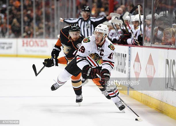 Jonathan Toews of the Chicago Blackhawks is chased by Tomas Fleischmann of the Anaheim Ducks in the first period of Game Five of the Western...