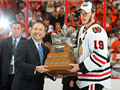 Jonathan Toews of the Chicago Blackhawks is presented with the Stanley Cup by NHL Commissioner Gary Bettman after defeating the Philadelphia Flyers...