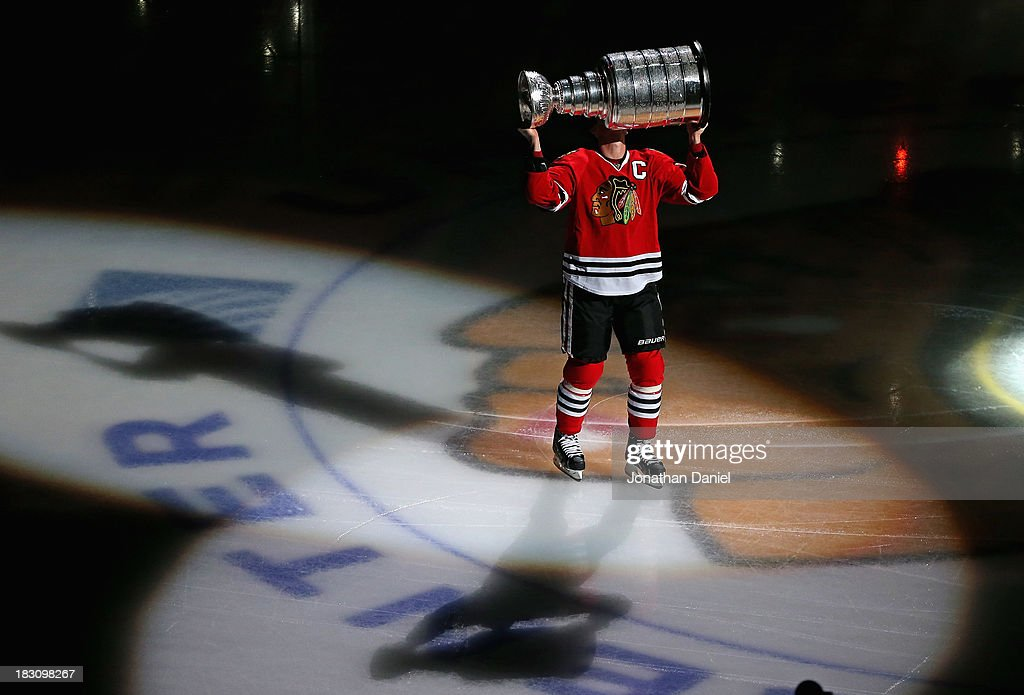 Jonathan Toews #19 of the Chicago Blackhawks kisses the Stanley Cup during a ceremony before taking on the Washington Capitals at the United Center on October 1, 2013 in Chicago, Illinois. The Blackhawks defeated the Capitals 6-4.
