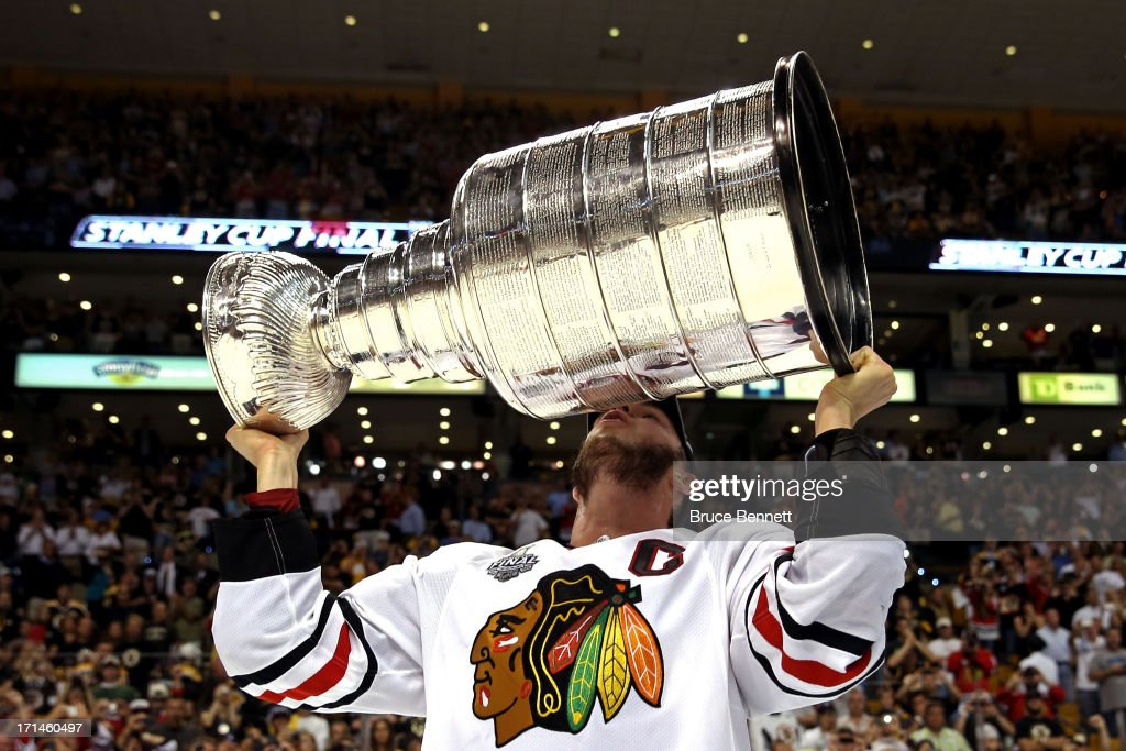 Jonathan Toews #19 of the Chicago Blackhawks kisses the Stanley Cup after defeating the Boston Bruins in Game Six of the 2013 NHL Stanley Cup Final at TD Garden on June 24, 2013 in Boston, Massachusetts. The Chicago Blackhawks defeated the Boston Bruins 3-2.