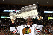 Jonathan Toews of the Chicago Blackhawks kisses the Stanley Cup after defeating the Boston Bruins in Game Six of the 2013 NHL Stanley Cup Final at TD...