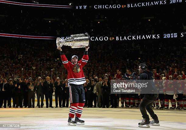 Jonathan Toews of the Chicago Blackhawks lifts the Stanley Cup in celebration after his team defeated the Tampa Bay Lightning 20 in Game Six of the...