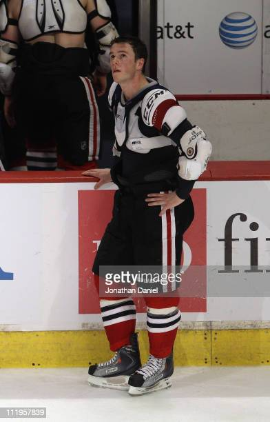Jonathan Toews of the Chicago Blackhawks looks up at the scoreboard after giving his jersey to a fan after a loss to the Detroit Red Wings at the...