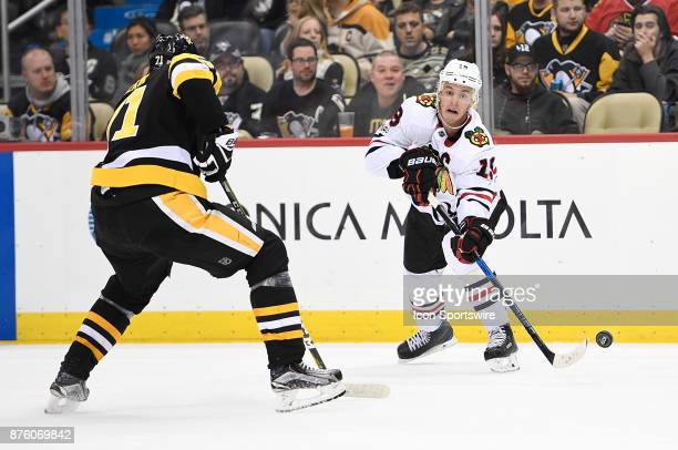 Jonathan Toews of the Chicago Blackhawks makes a pass as Evgeni Malkin of the Pittsburgh Penguins defends in the third period during the game at PPG...
