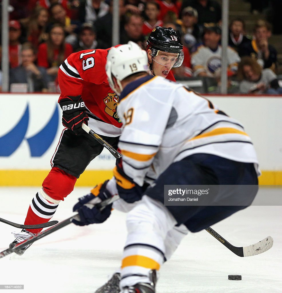 <a gi-track='captionPersonalityLinkClicked' href=/galleries/search?phrase=Jonathan+Toews&family=editorial&specificpeople=537799 ng-click='$event.stopPropagation()'>Jonathan Toews</a> #19 of the Chicago Blackhawks moves against the Buffalo Sabres at the United Center on October 12, 2013 in Chicago, Illinois. The Blackhawks defeated the Sabres 2-1.