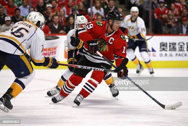 Jonathan Toews of the Chicago Blackhawks moves between PK Subban and Kevin Fiala of the Nashville Predators in Game One of the Western Conference...
