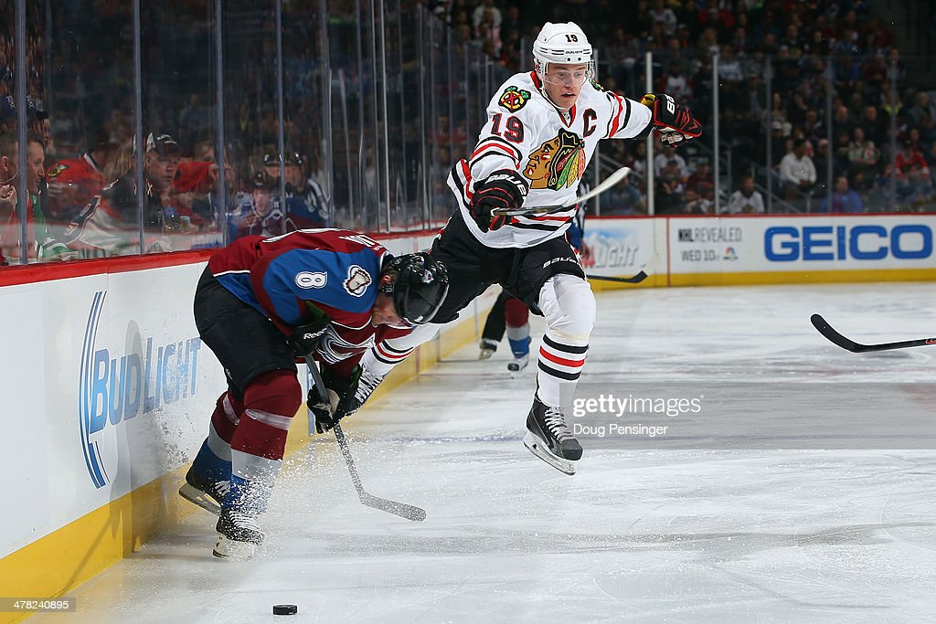 <a gi-track='captionPersonalityLinkClicked' href=/galleries/search?phrase=Jonathan+Toews&family=editorial&specificpeople=537799 ng-click='$event.stopPropagation()'>Jonathan Toews</a> #19 of the Chicago Blackhawks moves the puck past <a gi-track='captionPersonalityLinkClicked' href=/galleries/search?phrase=Jan+Hejda&family=editorial&specificpeople=624333 ng-click='$event.stopPropagation()'>Jan Hejda</a> #8 of the Colorado Avalanche at Pepsi Center on March 12, 2014 in Denver, Colorado.