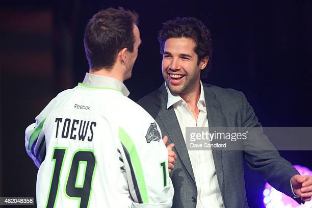 Jonathan Toews of the Chicago Blackhawks of Team Toews shakes the hand of his fellow Chicago Blackhawks teammate Corey Crawford of the Chicago...