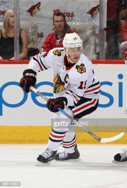 Jonathan Toews of the Chicago Blackhawks passes the puck against the Arizona Coyotes at Gila River Arena on October 21 2017 in Glendale Arizona