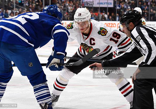 Jonathan Toews of the Chicago Blackhawks prepares for a faceoff with Tyler Bozak of the Toronto Maple Leafs during game action on January15 2016 at...