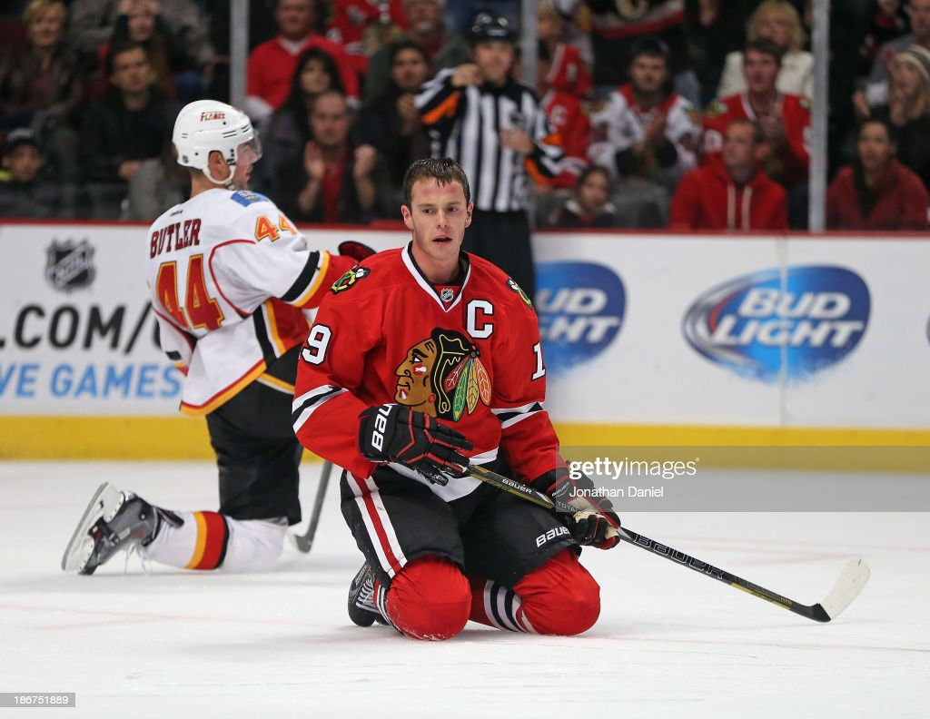 <a gi-track='captionPersonalityLinkClicked' href=/galleries/search?phrase=Jonathan+Toews&family=editorial&specificpeople=537799 ng-click='$event.stopPropagation()'>Jonathan Toews</a> #19 of the Chicago Blackhawks reacts after being taken down by Chris Butler #44 of the Calgary Flames at the United Center on November 3, 2013 in Chicago, Illinois. The Flames defeated the Blackhawks 3-2 in overtime.