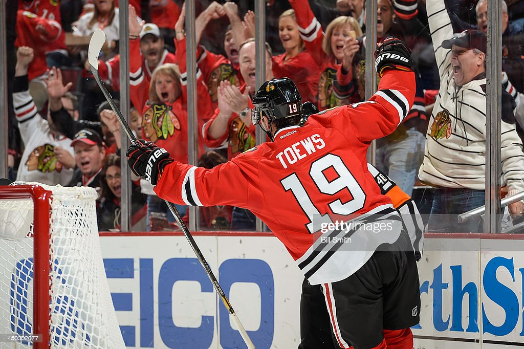 <a gi-track='captionPersonalityLinkClicked' href=/galleries/search?phrase=Jonathan+Toews&family=editorial&specificpeople=537799 ng-click='$event.stopPropagation()'>Jonathan Toews</a> #19 of the Chicago Blackhawks reacts after scoring against the San Jose Sharks in the third period during the NHL game on November 17, 2013 at the United Center in Chicago, Illinois.