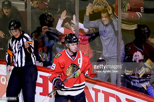 Jonathan Toews of the Chicago Blackhawks reacts after scoring against the Boston Bruins in the second period of the NHL game at the United Center on...