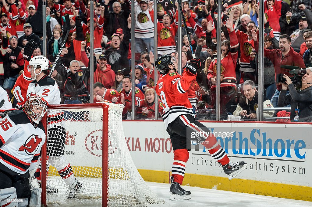 <a gi-track='captionPersonalityLinkClicked' href=/galleries/search?phrase=Jonathan+Toews&family=editorial&specificpeople=537799 ng-click='$event.stopPropagation()'>Jonathan Toews</a> #19 of the Chicago Blackhawks reacts after scoring on goalie <a gi-track='captionPersonalityLinkClicked' href=/galleries/search?phrase=Cory+Schneider&family=editorial&specificpeople=696908 ng-click='$event.stopPropagation()'>Cory Schneider</a> #35 of the New Jersey Devils in the third period during the NHL game at the United Center on February 13, 2015 in Chicago, Illinois.