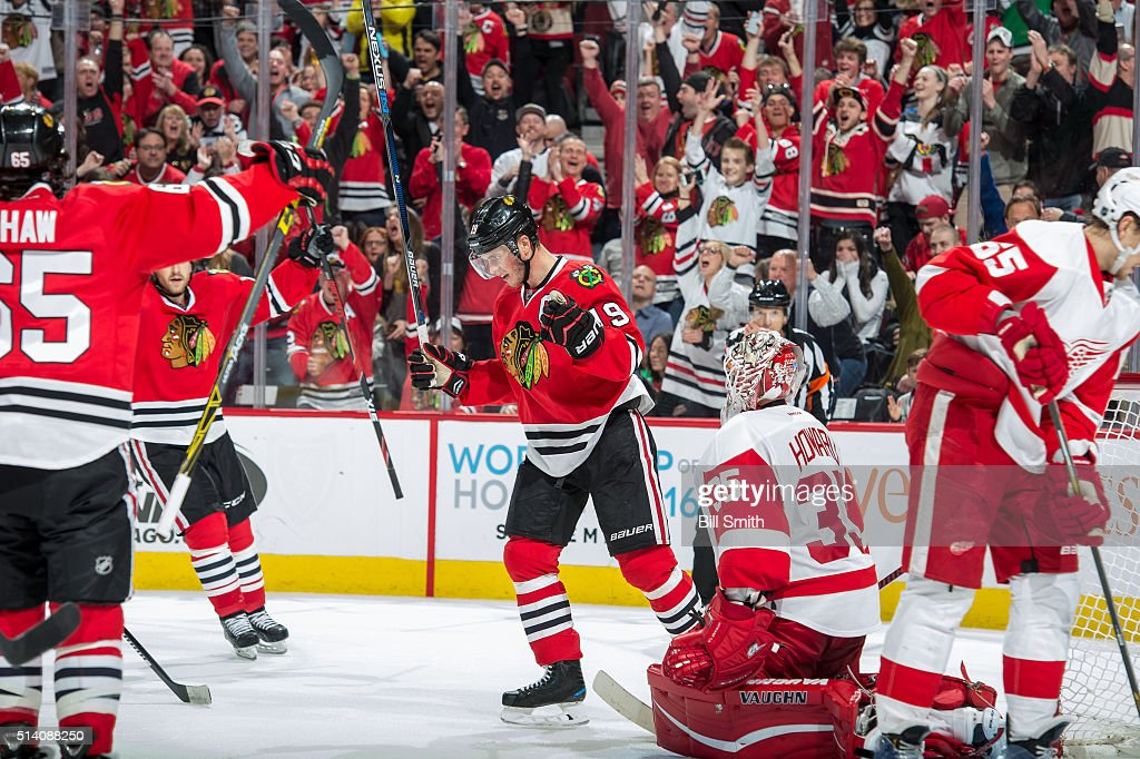 <a gi-track='captionPersonalityLinkClicked' href=/galleries/search?phrase=Jonathan+Toews&family=editorial&specificpeople=537799 ng-click='$event.stopPropagation()'>Jonathan Toews</a> #19 of the Chicago Blackhawks reacts after scoring on goalie <a gi-track='captionPersonalityLinkClicked' href=/galleries/search?phrase=Jimmy+Howard&family=editorial&specificpeople=2118637 ng-click='$event.stopPropagation()'>Jimmy Howard</a> #35 of the Detroit Red Wings in the third period of the NHL game at the United Center on March 6, 2016 in Chicago, Illinois.