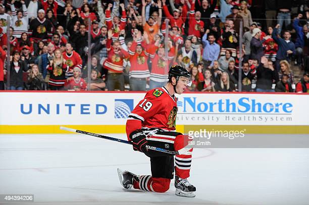 Jonathan Toews of the Chicago Blackhawks reacts after scoring the game winning goal in overtime against the Anaheim Ducks during the NHL game at the...