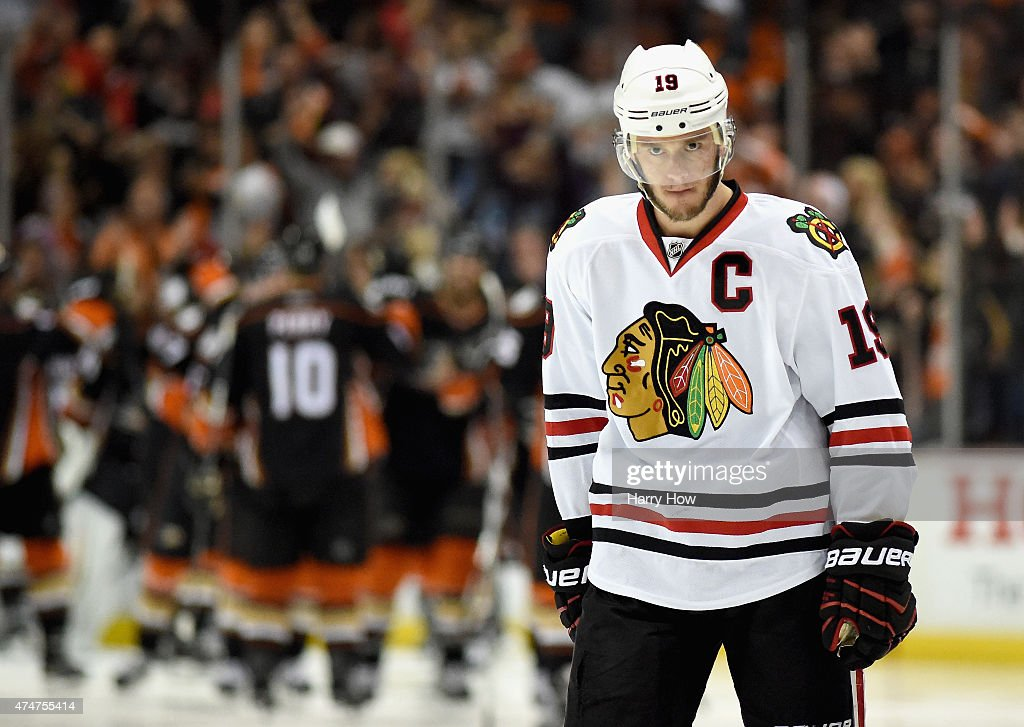 Jonathan Toews #19 of the Chicago Blackhawks reacts after the Anaheim Ducks scored in overtime to win Game Five of the Western Conference Finals during the 2015 NHL Stanley Cup Playoffs at Honda Center on May 25, 2015 in Anaheim, California. Matt Beleskey #39 of the Anaheim Ducks scored the game winning goal to win the game 5-4.