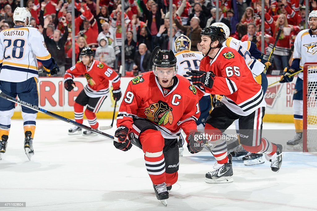 <a gi-track='captionPersonalityLinkClicked' href=/galleries/search?phrase=Jonathan+Toews&family=editorial&specificpeople=537799 ng-click='$event.stopPropagation()'>Jonathan Toews</a> #19 of the Chicago Blackhawks reacts in front of <a gi-track='captionPersonalityLinkClicked' href=/galleries/search?phrase=Andrew+Shaw+-+Jogador+de+h%C3%B3quei+no+gelo&family=editorial&specificpeople=10568695 ng-click='$event.stopPropagation()'>Andrew Shaw</a> #65 after scoring against the Nashville Predators in the first period in Game Six of the Western Conference Quarterfinals during the 2015 NHL Stanley Cup Playoffs at the United Center on April 25, 2015 in Chicago, Illinois.