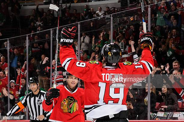 Jonathan Toews of the Chicago Blackhawks reacts with Patrick Kane after scoring in the second period of the NHL game against the Philadelphia Flyers...