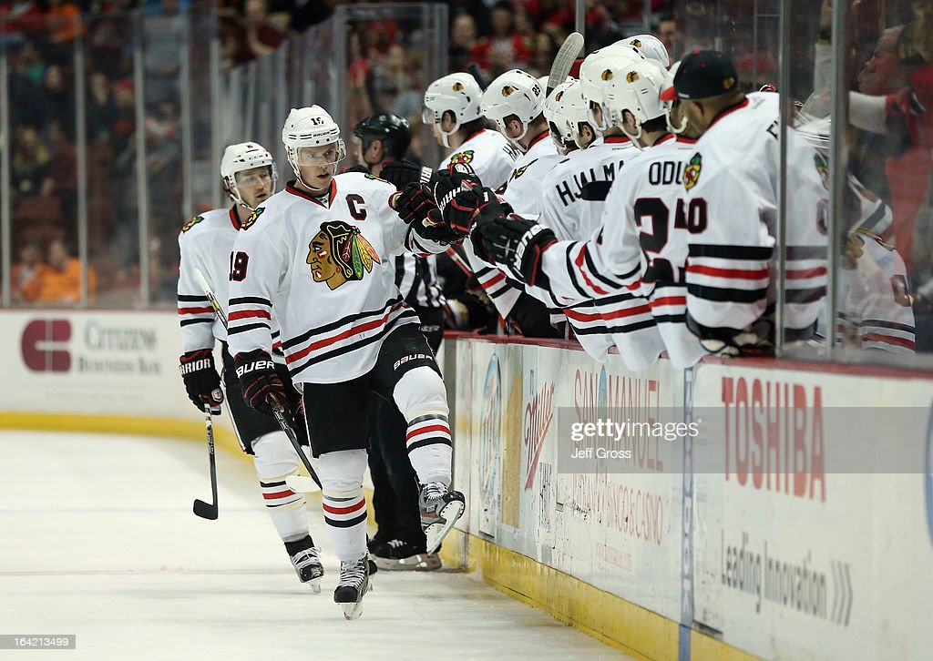 Jonathan Toews #19 of the Chicago Blackhawks receives high fives from the bench after scoring a shorthanded goal against the Anaheim Ducks in the first period at Honda Center on March 20, 2013 in Anaheim, California.